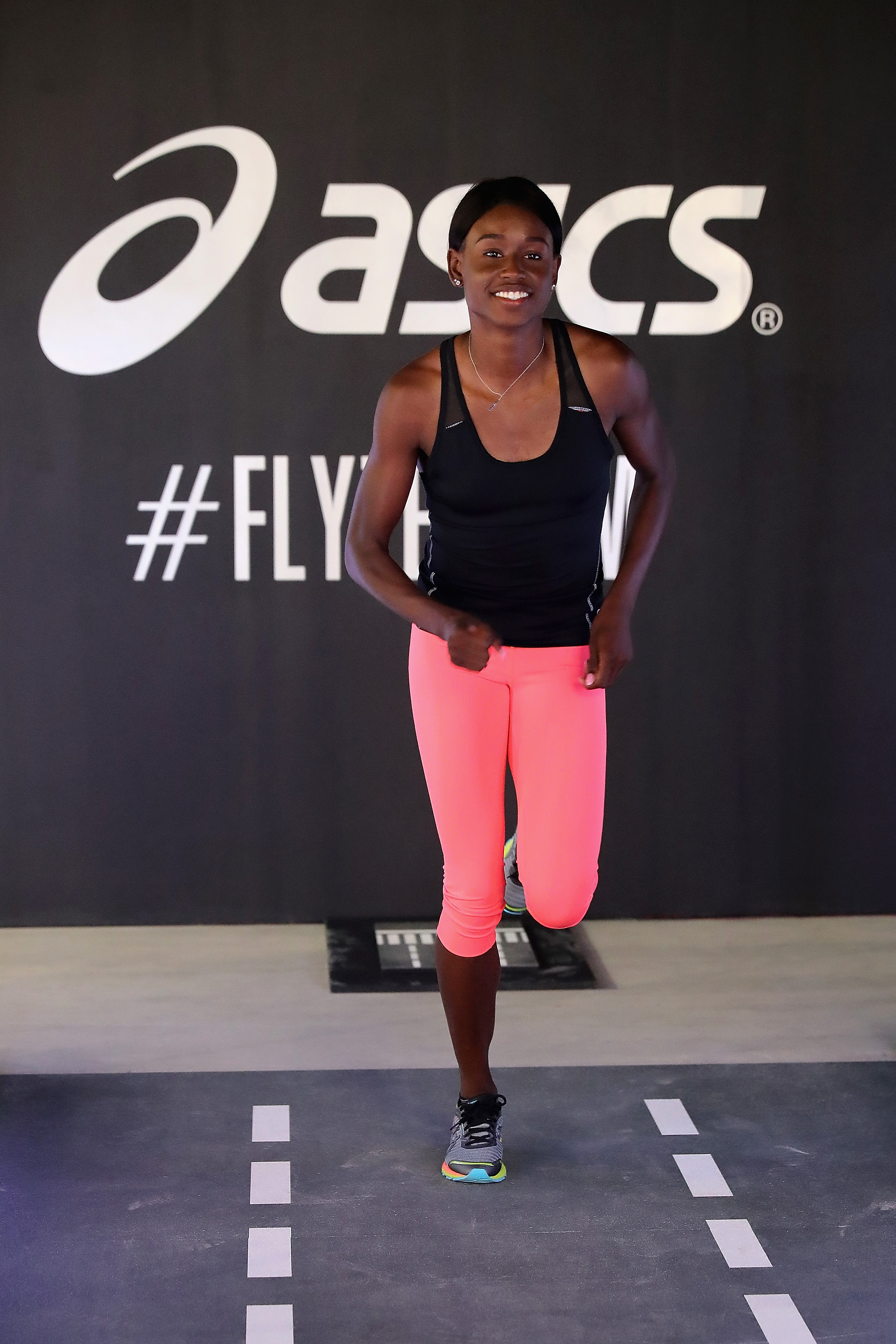 NEW YORK, NY - JUNE 14: ASICS elite athlete Candace Hill takes a demo run on the DynaFlyte Deck test track, showing off the new DynaFlyte shoe, ASICS lightest-ever cushioning shoe for runners who want speed at the Global Launch Event on June 14, 2016 in New York City. (Photo by Neilson Barnard/Getty Images for ASICS)